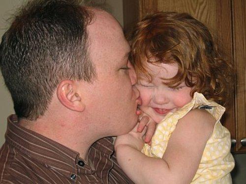 Brian_kissing_a